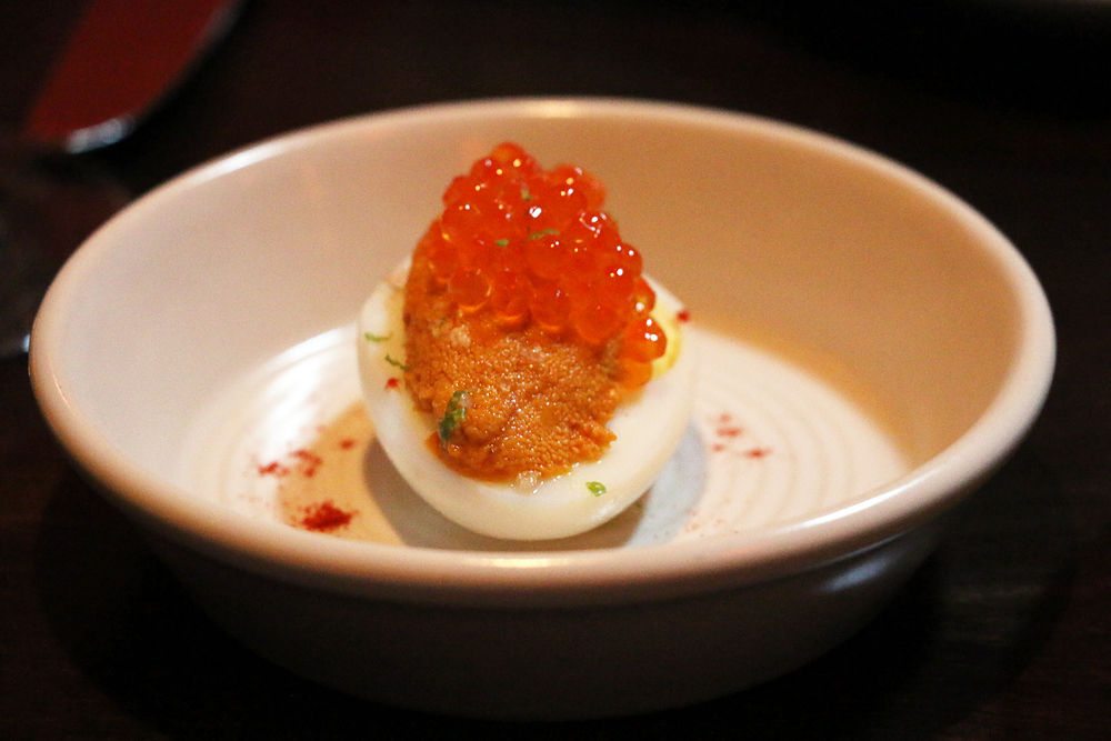 Deviled egg with caviar and sea urchin.