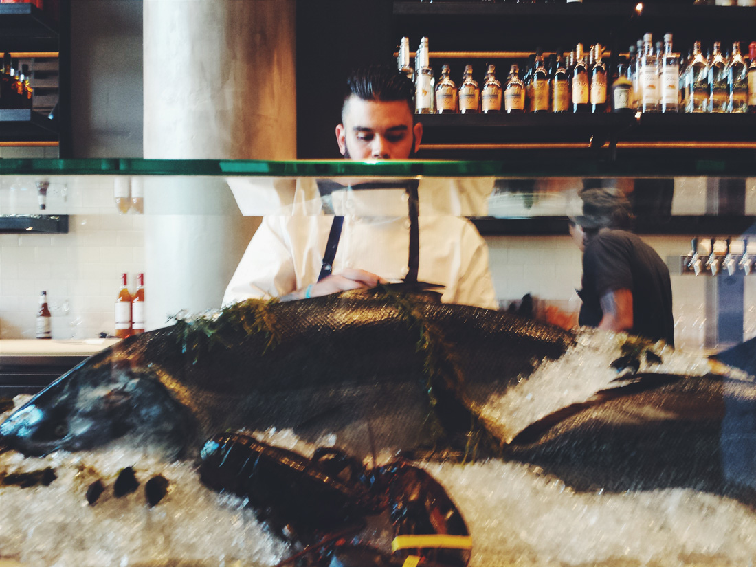 The raw bar provides a centerpiece for the space.