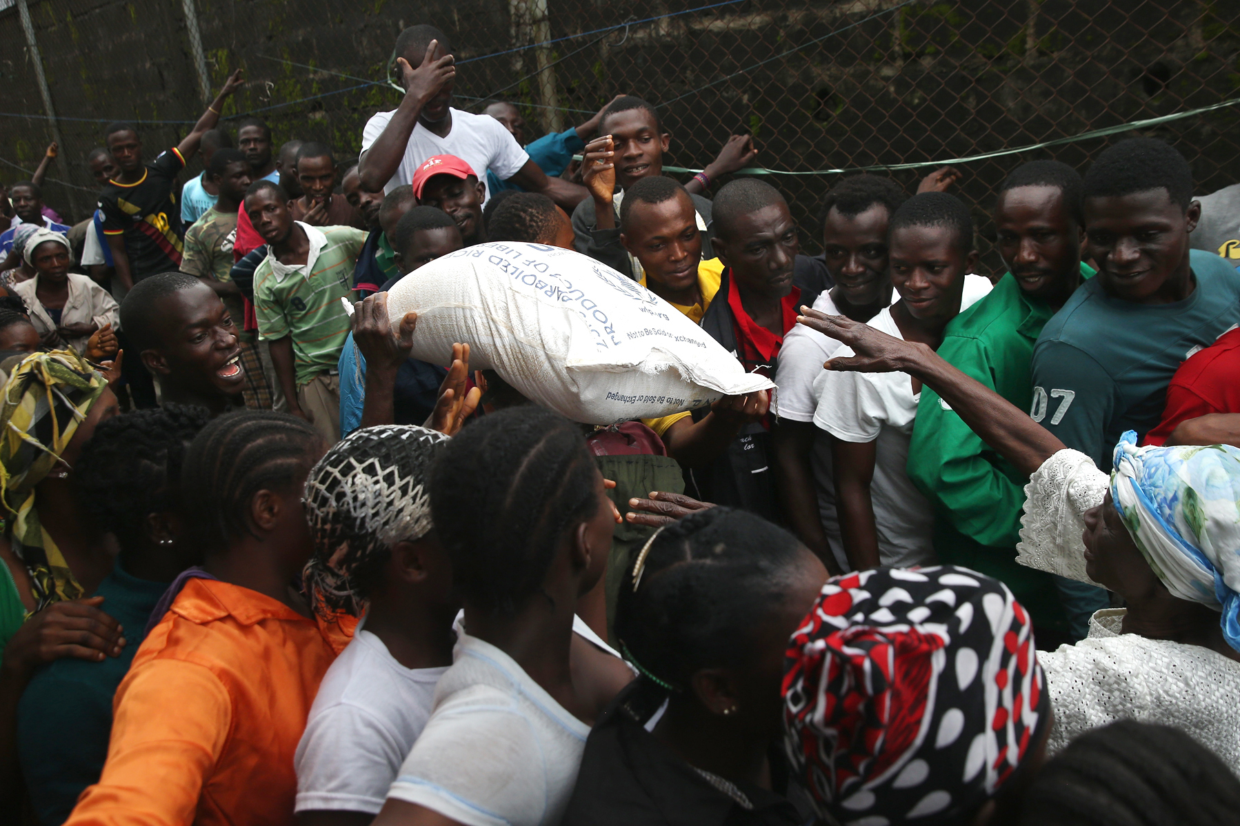 The Liberian government delivered bags of rice, beans and cooking oil to residents of the West Point slum in Monrovia. The community has been quarantined because of the Ebola outbreak in the area. Photo: John Moore/Getty Images