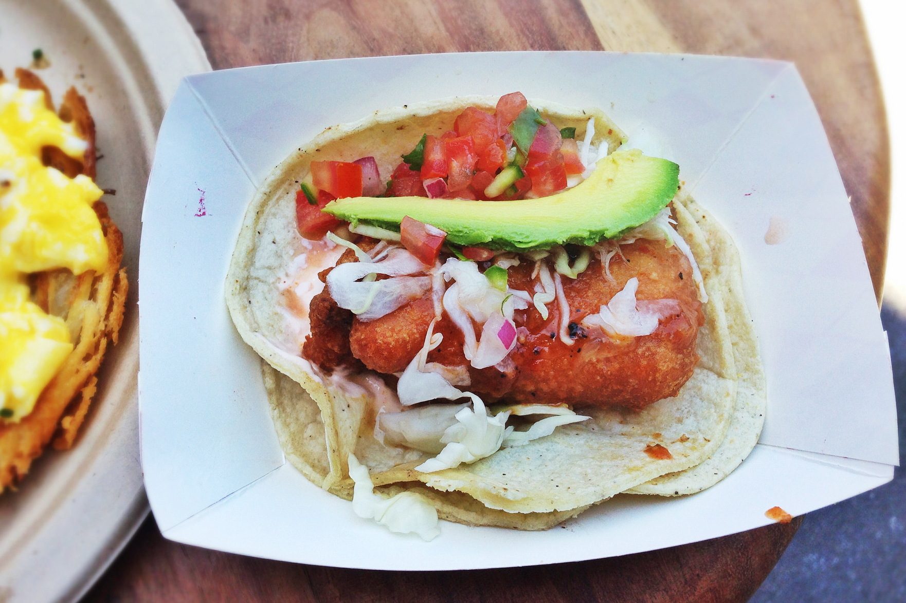 Take a bite — or or maybe don't — of this beer-battered mako shark taco with cabbage, pico de gallo, avocado, arbol chile and cream from Guerilla Tacos in Los Angeles. Photo: T. Tseng/Flickr