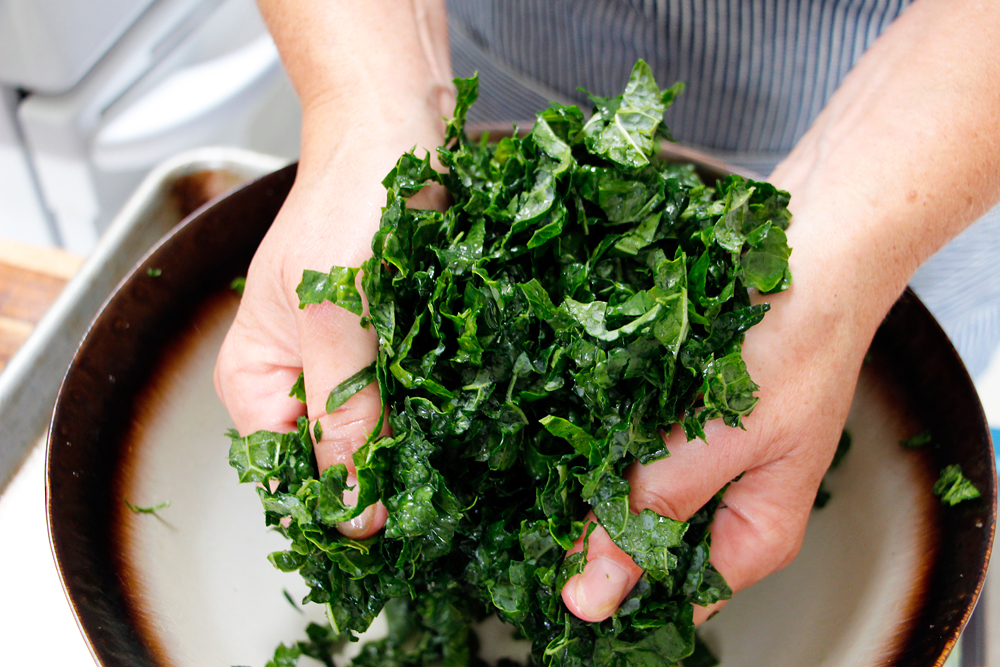 Gently massage the kale. Photo: Wendy Goodfriend