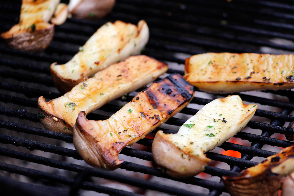 Grill the mushrooms, turning frequently, until tender and browned, 6–8 minutes. Photo: Wendy Goodfriend