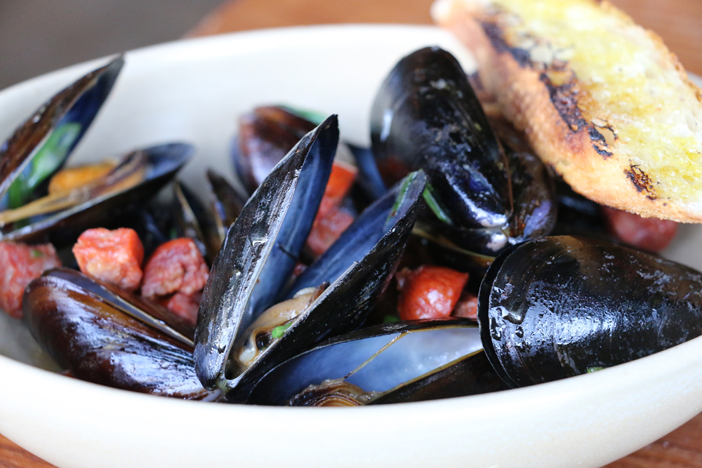 Mussels with Spanish chorizo. Photo: Kim Westerman
