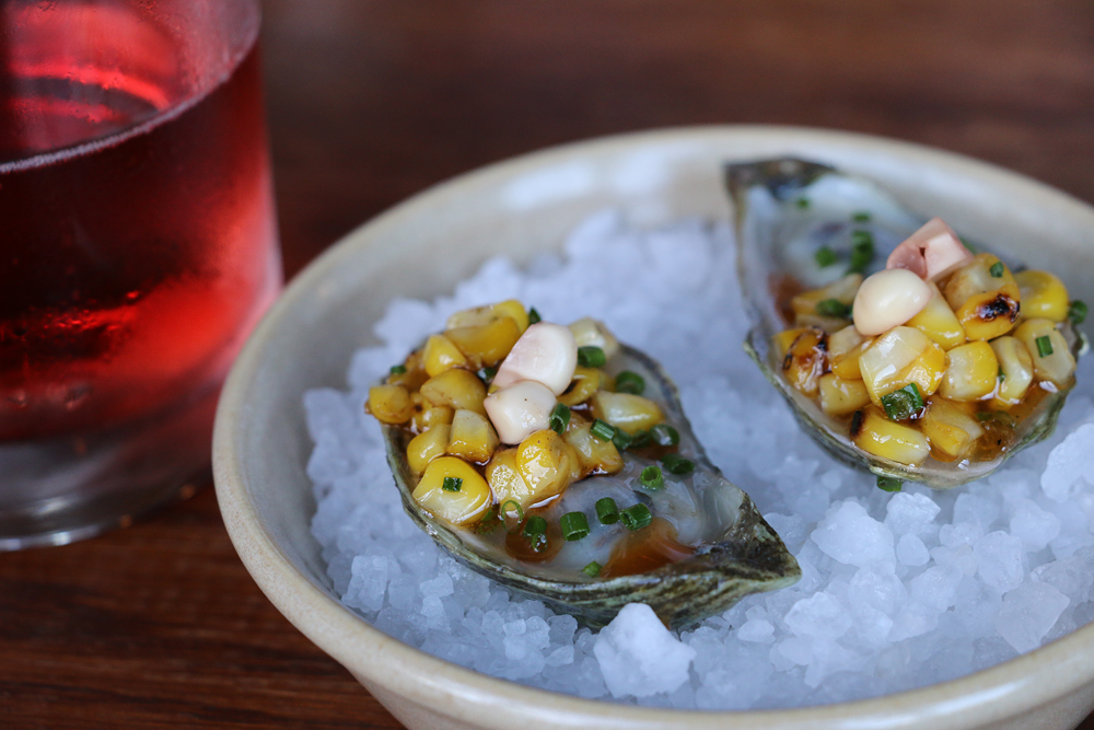 Marin Atlantic oysters with roasted corn and bay leaf. Photo: Kim Westerman