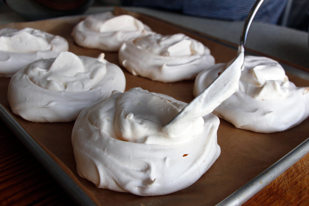 Spoon whipped cream into the meringues. Photo: Wendy Goodfriend