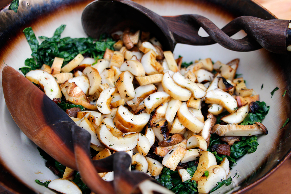 Add the sliced mushrooms and toss the salad. Photo: Wendy Goodfriend