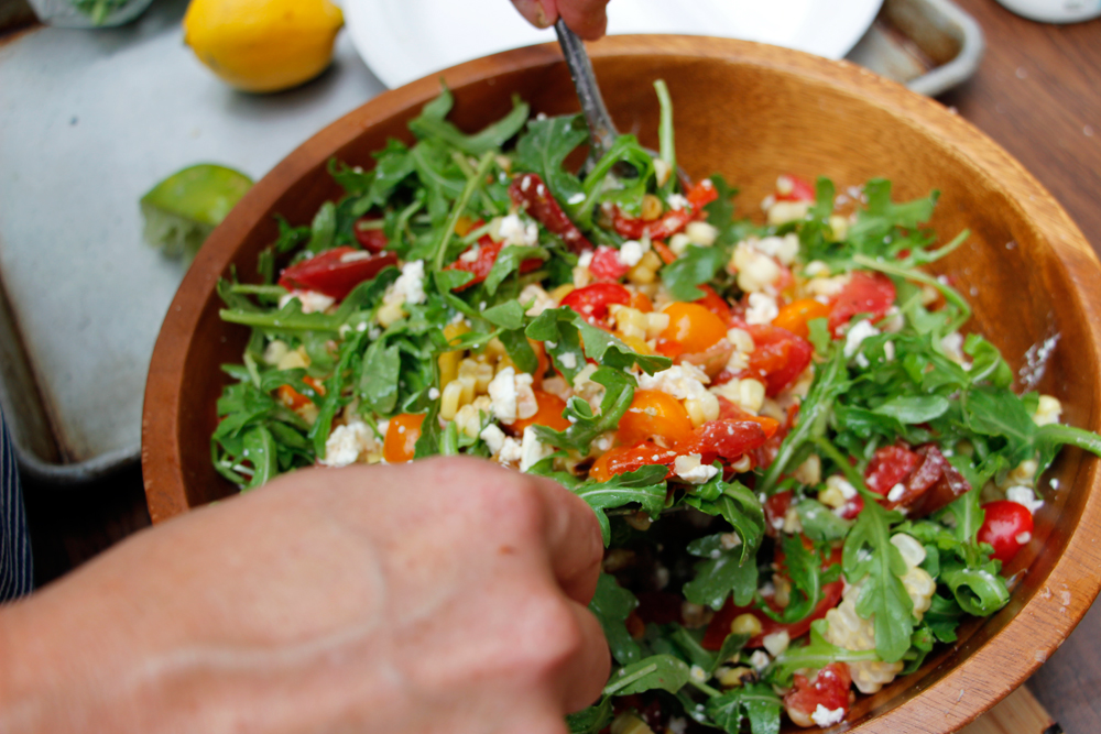 Drizzle with a little olive oil and the lime juice and toss to coat. Add the feta and arugula and gently toss to coat. Photo: Wendy Goodfriend