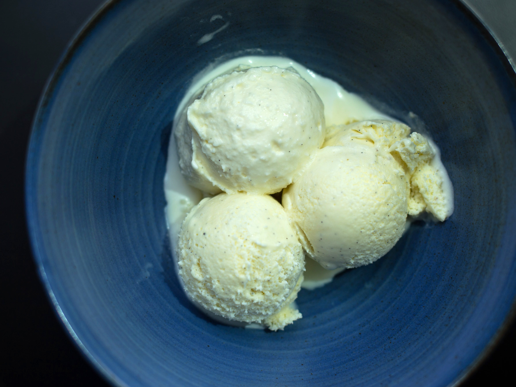 Three scoops of vanilla ice cream made with vanilla beans from Mexico, Tahiti and Madagascar. Photo: Meredith Rizzo/NPR