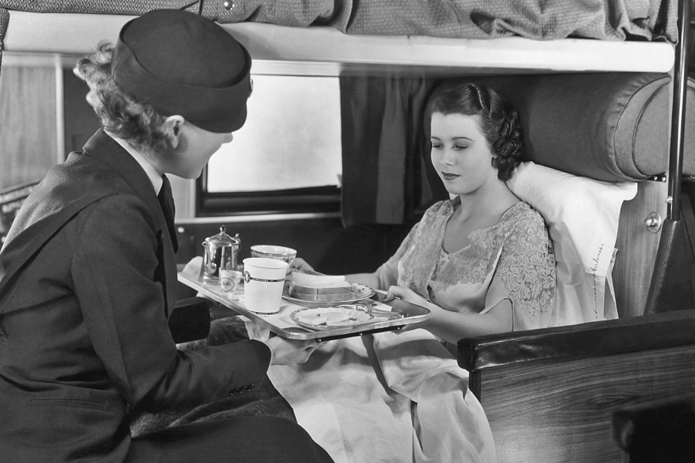 The good old days: A flight attendant serves coffee and sandwiches to a passenger on board an American Airlines flight, circa 1935. Photo: Frederic Lewis/Archive Photos/Getty Images