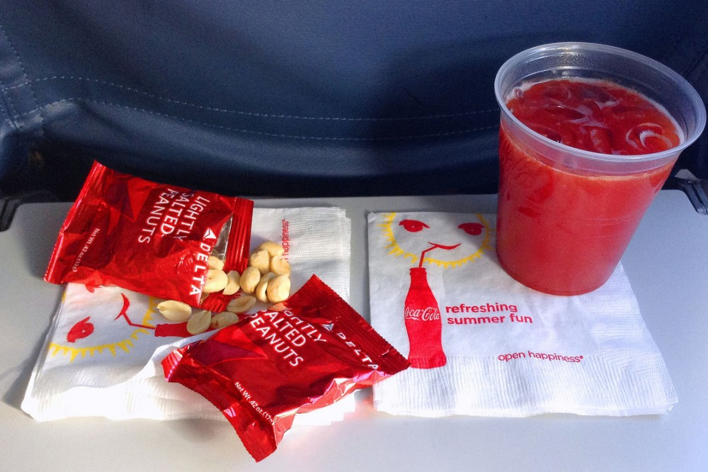 Hungry? These peanuts and drink, served aboard a Delta flight in July, are about all you'll get on domestic flights these days. Photo: Ron Cogswell/Flickr