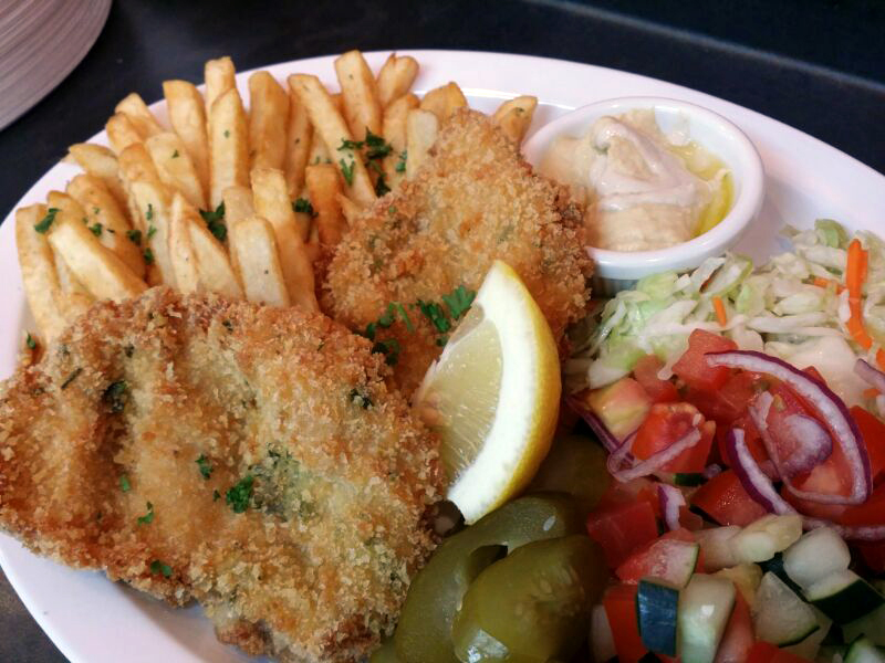 Chicken schnitzel is a popular dish on the Amba menu. Photo: Amba