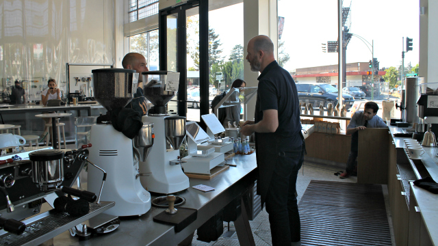 A barista talks to a customer at Blue Bottle's W.C. Morse location in Oakland. Photo: Shelby Pope