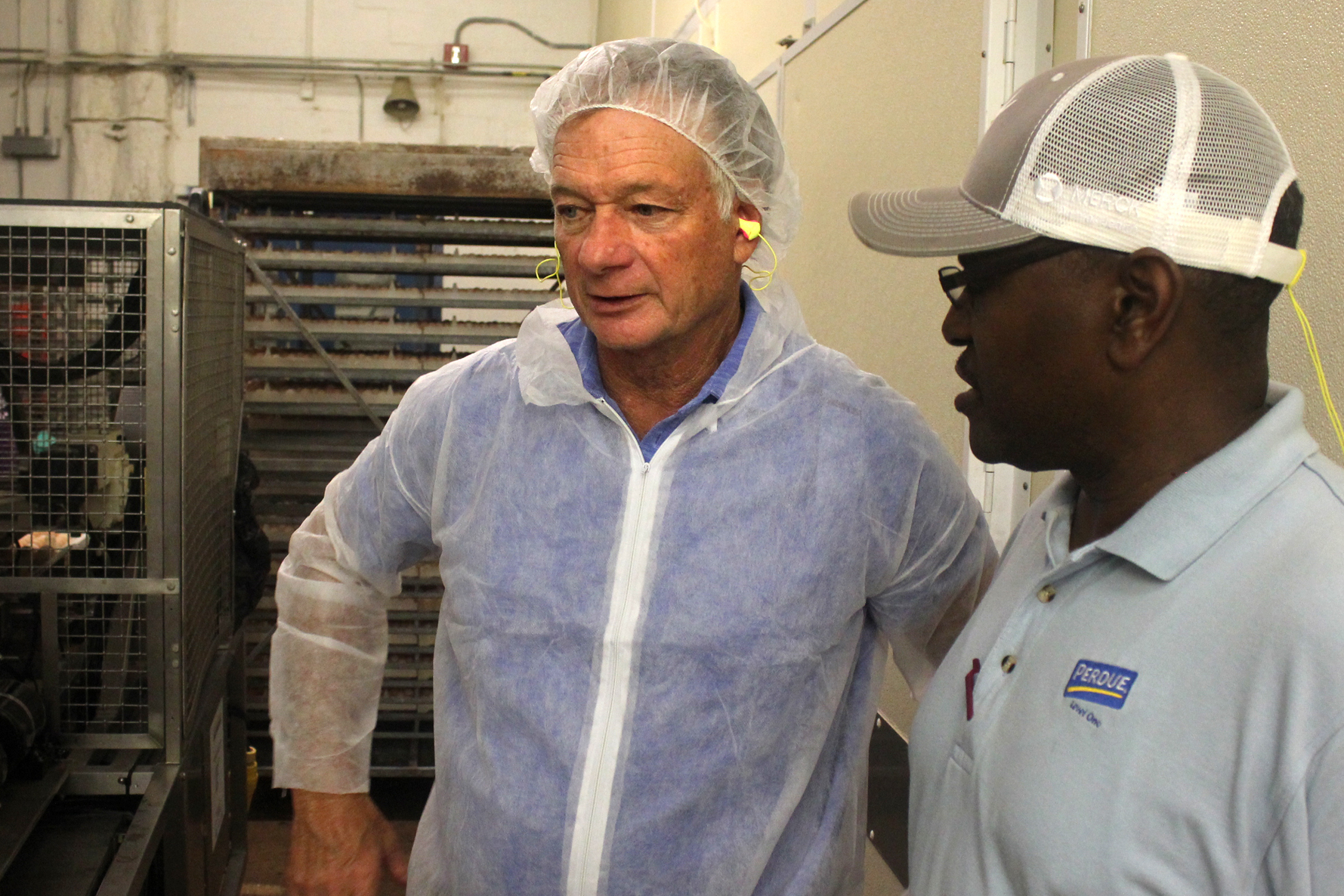 At left, CEO Jim Perdue inside the company's hatchery in Salisbury, Md. Photo: Dan Charles/NPR