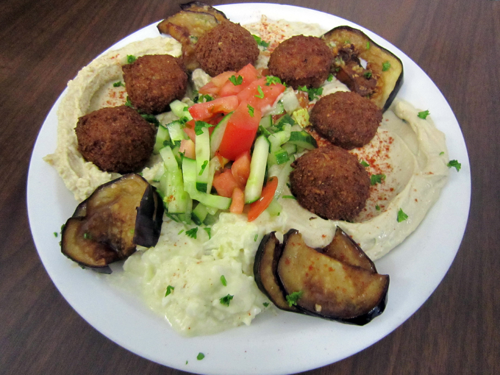 This combination plate with falafel, humus, babaganoush and fried eggplant is popular among vegetarians at Sabra Grill. Photo: Alix Wall