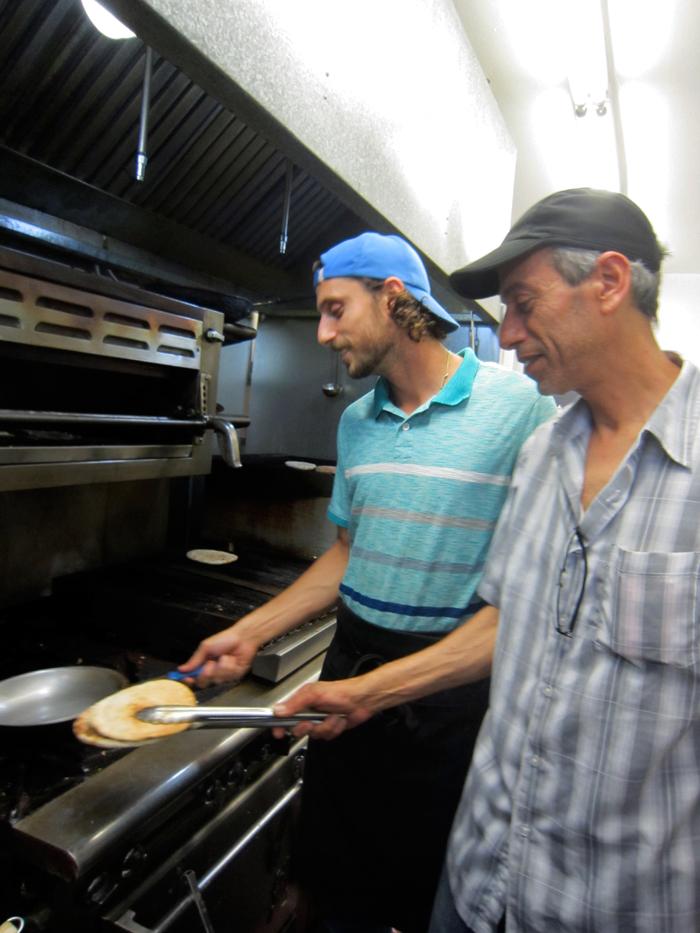 Sabra Grill's Eitan Hilleli mans the stove of Sabra Grill with his son Joseph. Photo: Alix Wall