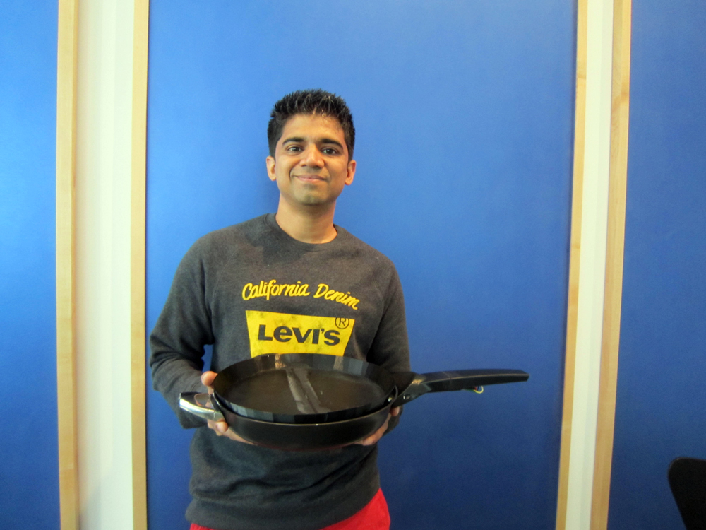 Rahul Baxi holds the first prototype of the SmartyPan. Photo: Alix Wall