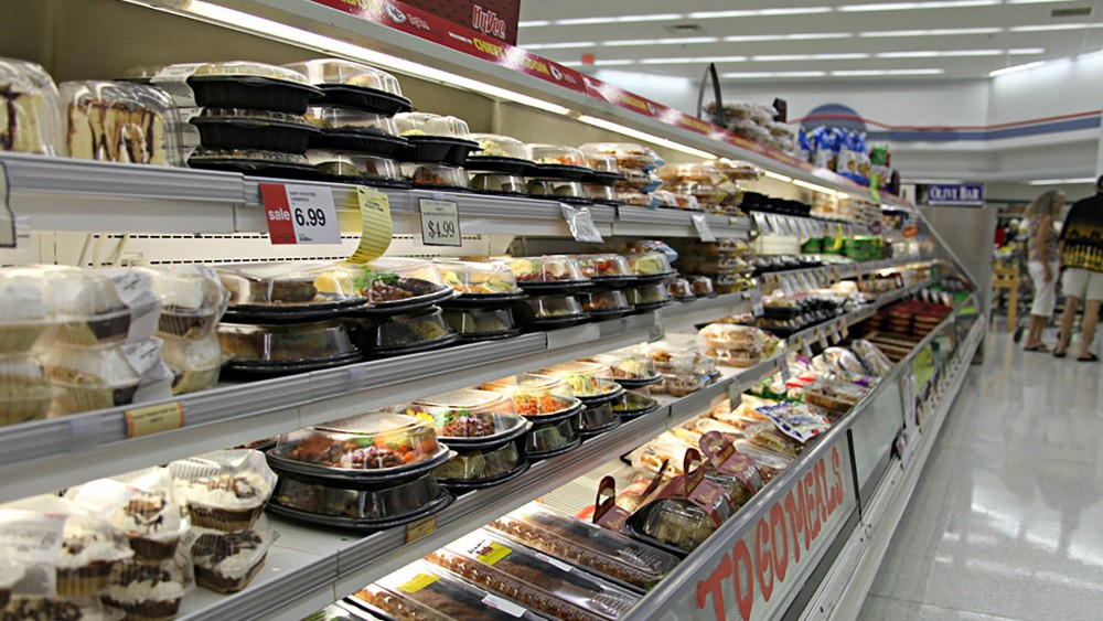 Ready-to-eat meals found in the prepared food aisle are a growing source of waste, as it is difficult to reuse meals that aren't sold but are fully cooked. Photo: Kristofor Husted/Harvest Public Media
