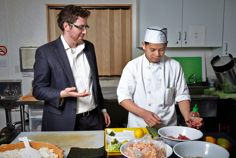 Rabbi Alex Shandrovsky has started L'Chaim Sushi, which is also offering kosher diners another option. Here he is pictured with one of his sushi chefs, Jagun Ney. Photo: L'Chaim Sushi