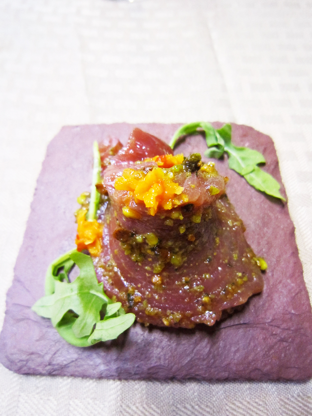 This tuna loin with mint and pistachio pesto and citrus zest fermented with chiles was a course at the kosher pop-up. Photo: Alix Wall