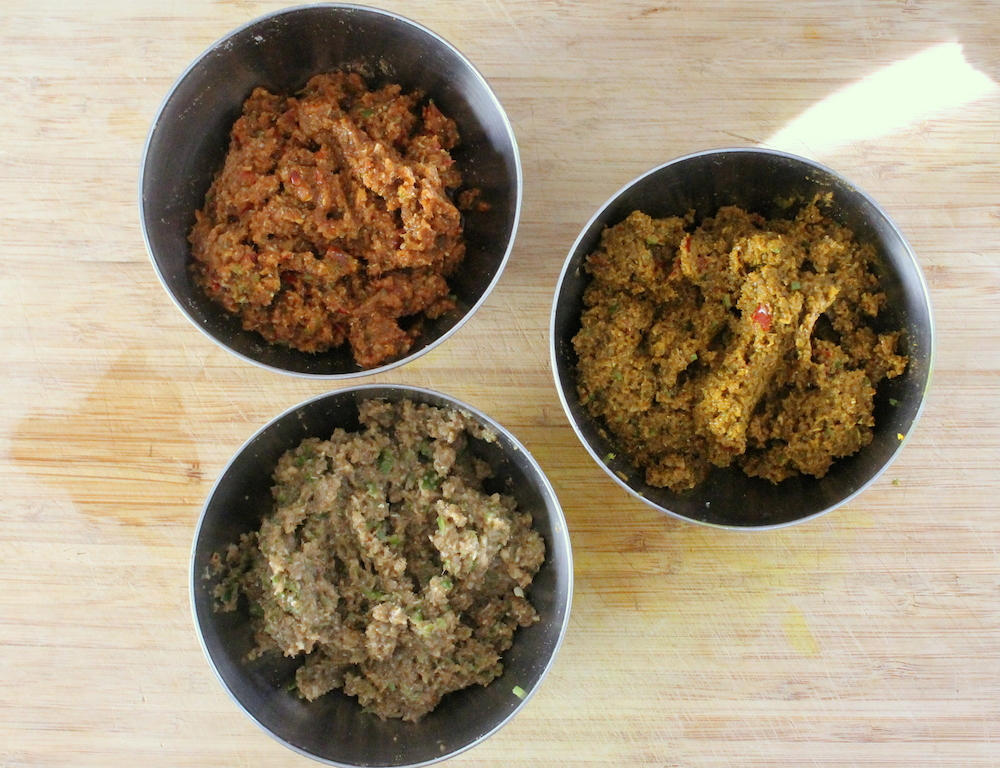 Homemade Thai curry paste in three shades: red, yellow, and green. Photo: Kate Williams
