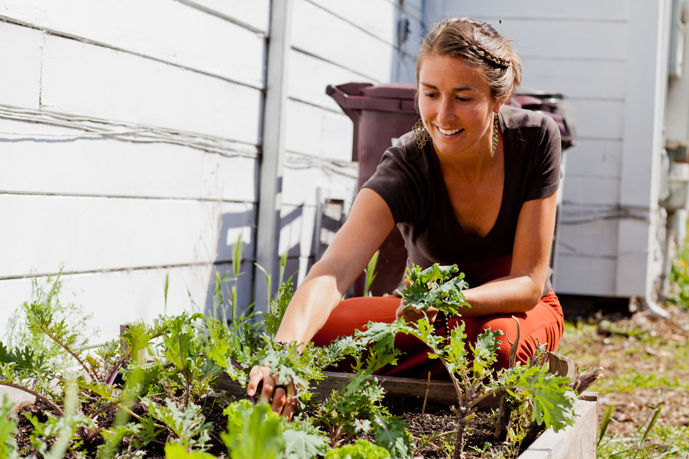 Dana Frasz, the executive director of Oakland's Food Shift, grows kale in her own West Oakland garden. Right now she is helping to organize the Feeding the 5000 event on Sunday. Photo: Jordan Schuster