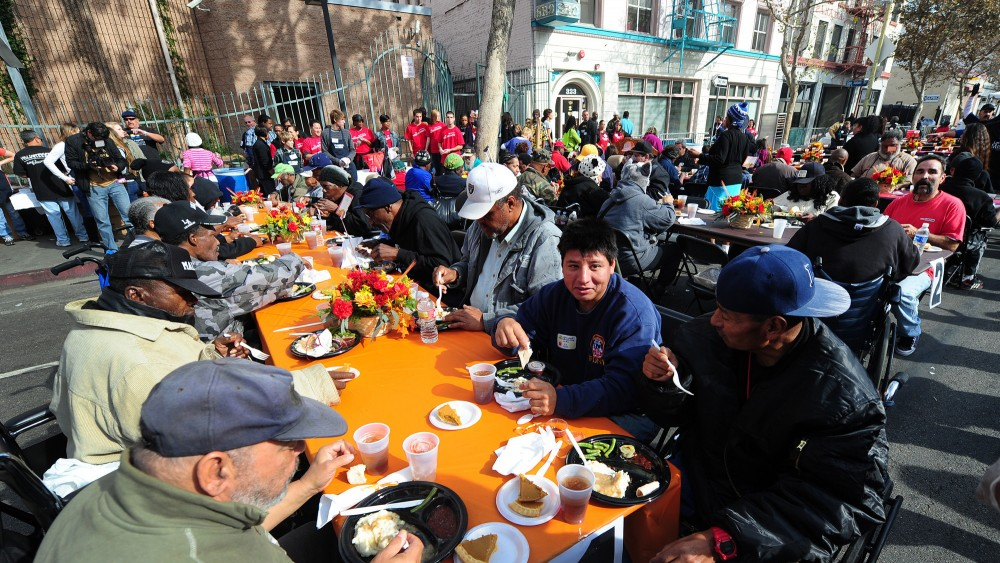 The homeless and others in need enjoy lunch at the Los Angeles Mission on Nov. 23, 2011, in celebration of Thanksgiving. Legislation to ban organizations from serving food to homeless people in public places has been proposed in Los Angeles. Photo: Frederic J. Brown/AFP/Getty Images