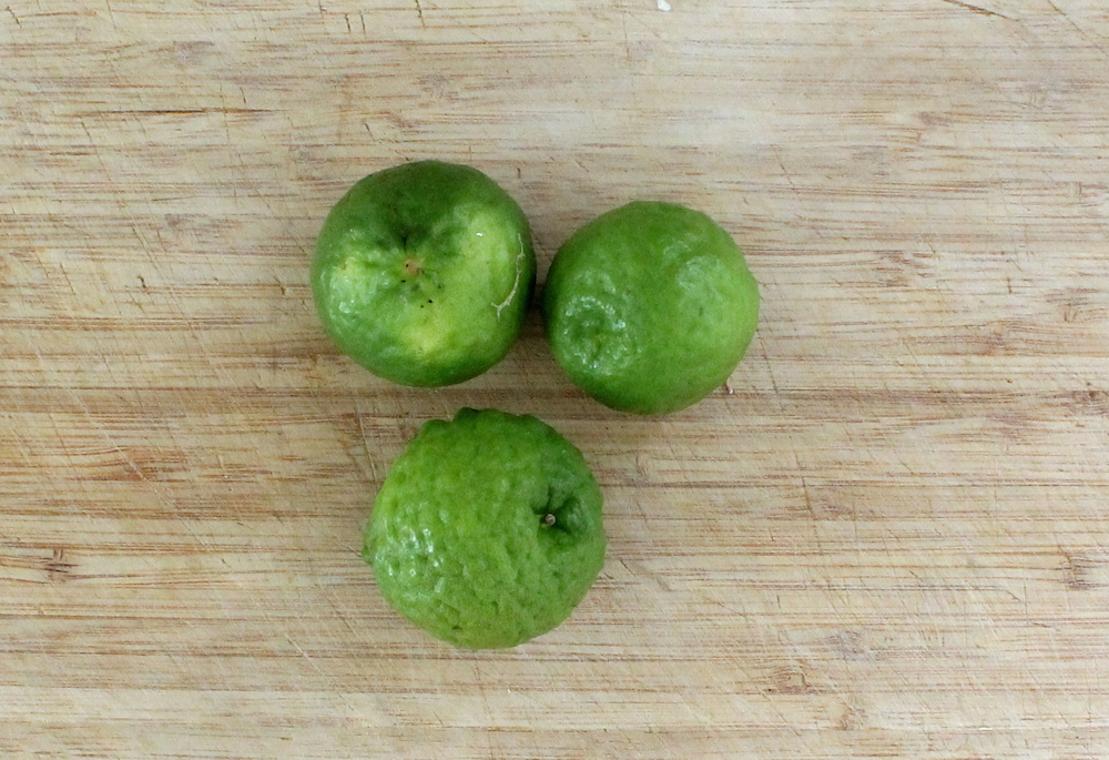 Kaffir limes have a distinct floral character that isn't seen in standard lime varieties. They are also sweeter and less tart than their cousins. Kaffir limes have a mottled exterior and a round shape, similar to a miniature navel orange. If you can't find kaffir limes, you can substitute chopped fresh kaffir lime leaves or standard lime zest. Photo: Kate Williams