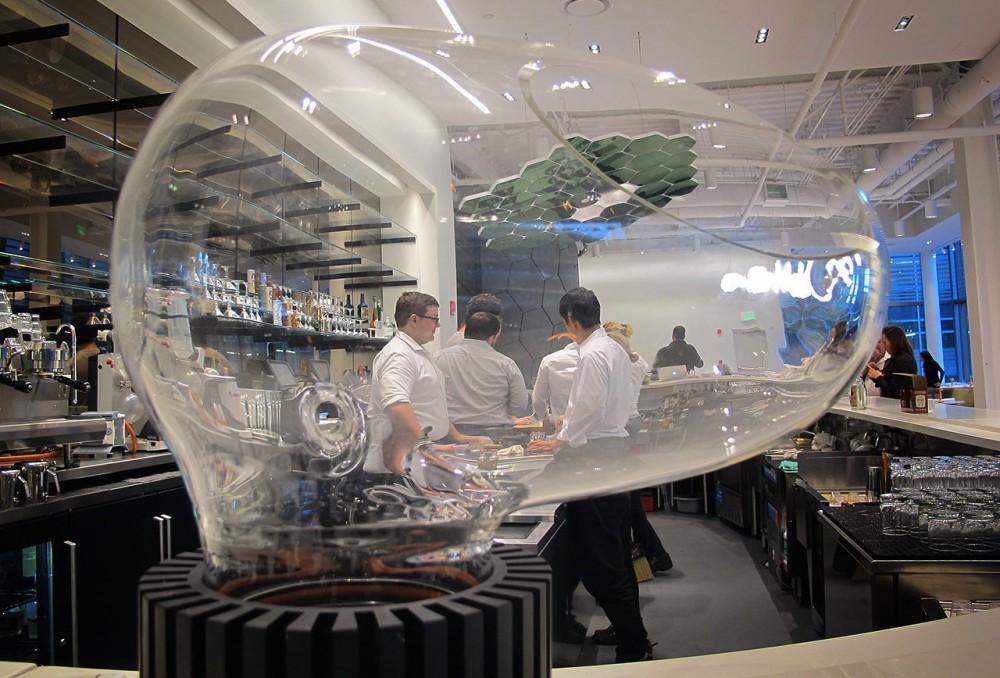 Le Laboratoire Cambridge features a restaurant, the Cafe ArtScience. The restaurant's bar features a glass-globed drink vaporizer called Le Whaf. Photo: Andrea Shea/WBUR
