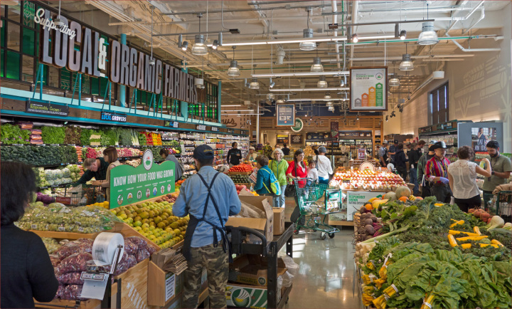Customers shop for produce in Berkeley's second Whole Foods store which opened today at Tenth and Gilman streets. Photo: Neil Mishalov