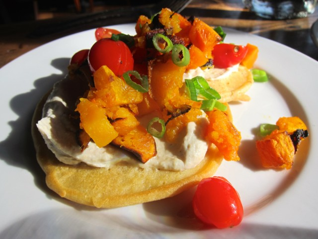 "Sanctuary Bistro Socca Cakes: chickpea griddlecakes with roasted butternut squash, housemade cashew ""cheese"", scallions and cherry tomatoes"