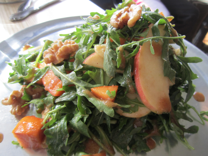 A salad of shaved apples and persimmons, arugula, apple butter vinaigrette, Point Reyes blue crema and toasted walnuts. Photo: Alix Wall