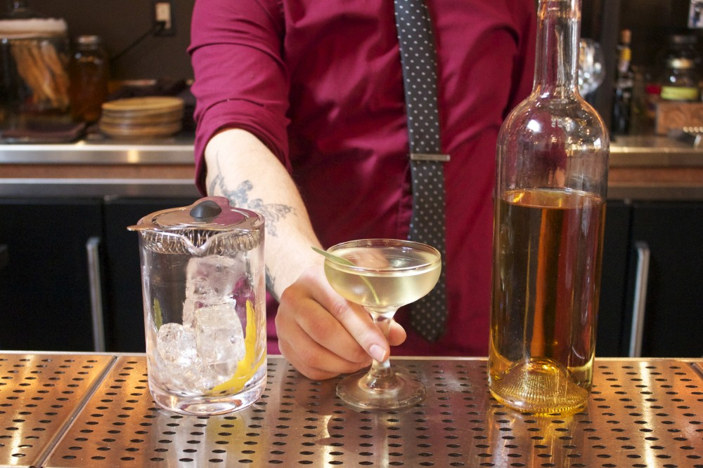 Anthony Keels, bar manager at Verbena in San Francisco, Calif., serves up a cocktail made with barrel-aged, dark gin. Keels calls this gin a game-changer. Photo: Stacy Adimando for NPR