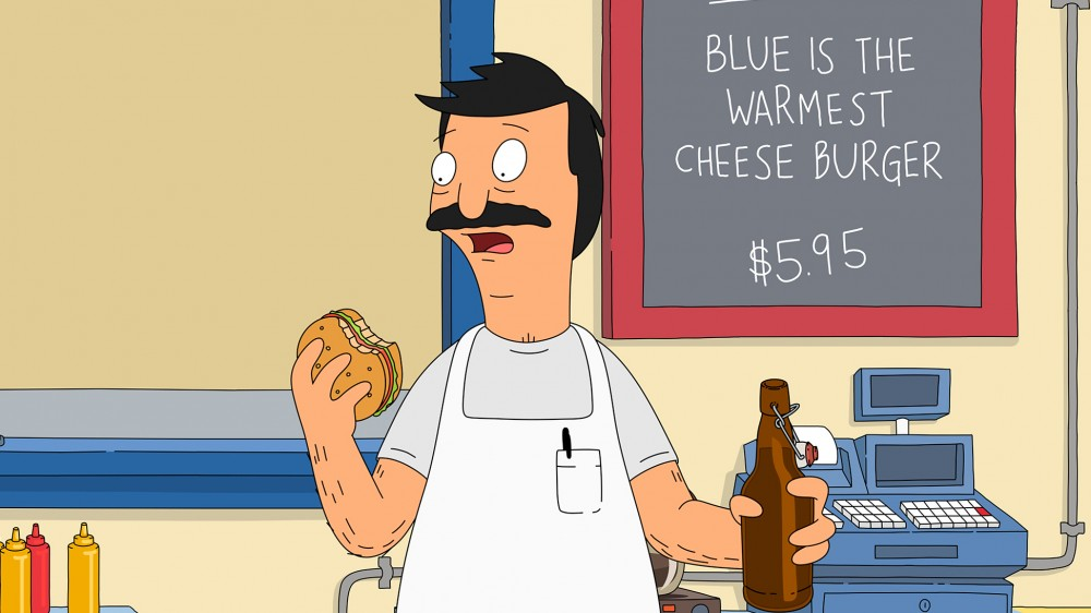Bob Belcher, titular hero of Bob's Burgers, bites into one of his creations. Each episode features daily burger specials with chuckle-inducing names. The burgers were born in the show writers' imagination and brought to life in Cole Bowden's kitchen. Image: Fox/via Getty Images