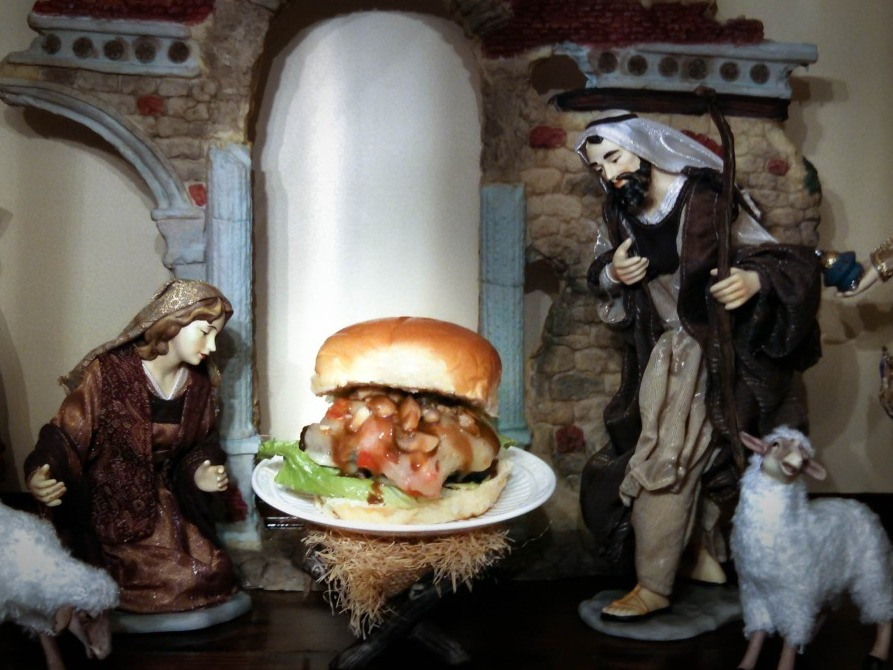 "The ""Cheeses Is Born Burger,"" displayed on Bowden's mother's Nativity scene. ""My mom was not too thrilled with me taking baby Jesus out of the scene and putting a burger in its place,"" says Bowden. Photo: Courtesy of Cole Bowden"