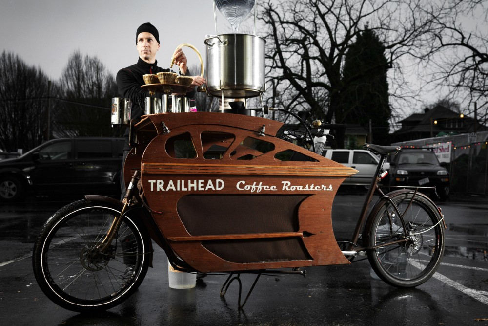 Charlie Wicker of Trailhead Coffee Roasters makes all of his deliveries within the 6-mile radius of urban Portland, Ore., on one of his custom-built cargo bikes. He can also pull over to brew and serve coffee. Photo: John Lee/Courtesy of Trailhead Coffee Roasters
