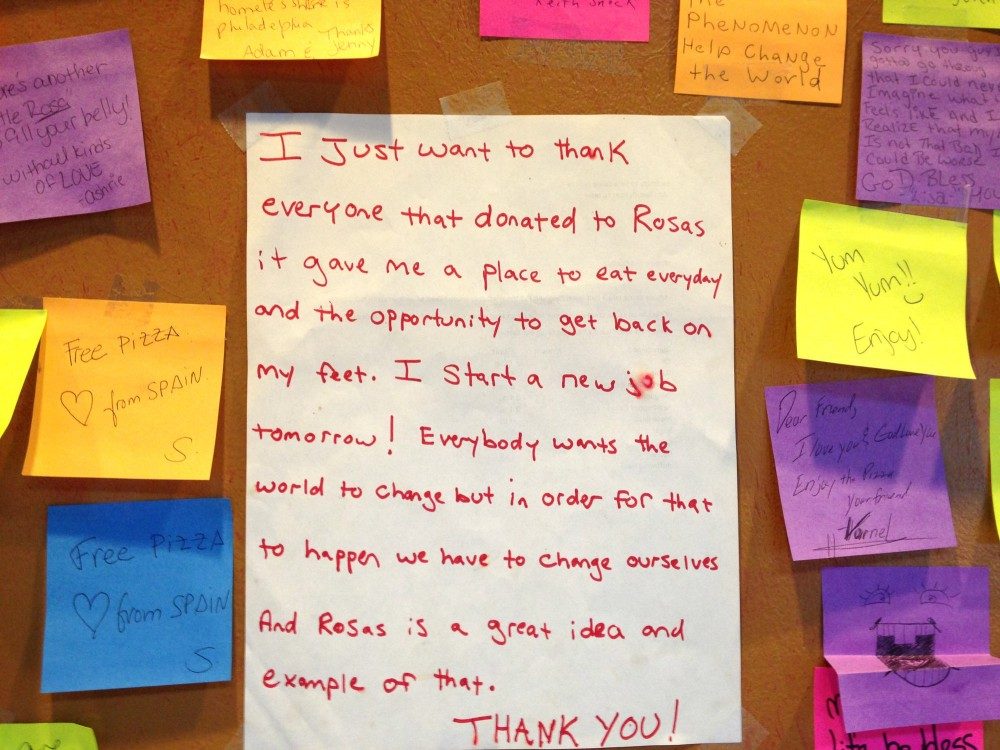 Messages adorn the walls of a Philadelphia pizza shop where customers pay an extra $1 to feed a person who is homeless. Photo: Courtesy of Mason Wartman