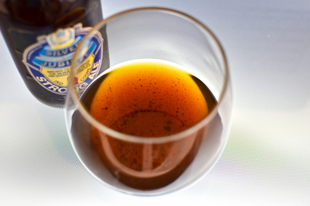 Sediment in a glass of 1977 Ind Coope Strong Ale. Proteins in very old beers can coagulate into chunks at the bottom of the bottle, Patrick Dawson explains in Vintage Beer. Photo: Courtesy of Lindsay Dawson