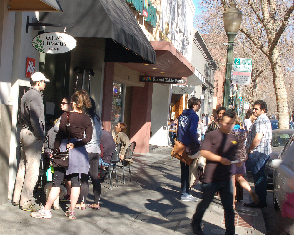Oren's Hummus always has a line, with patrons attracted by the moderately priced food featuring garbanzo beans imported from Israel. Photo: Susan Hathaway