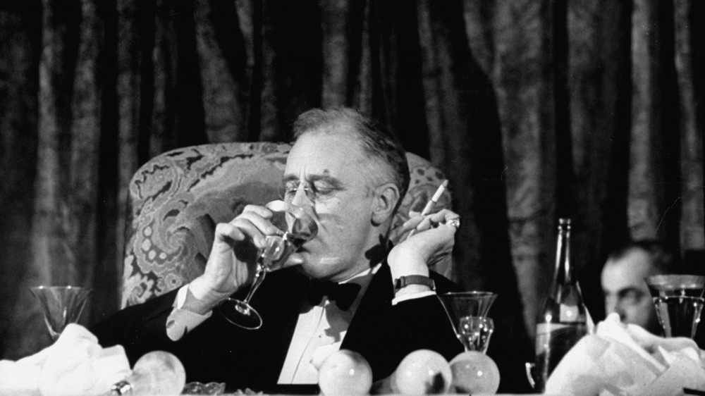 President Franklin Delano Roosevelt drinks a glass of wine at a fundraising dinner in 1938. FDR fancied himself quite the skilled mixologist; many of his colleagues disagreed. Photo: Thomas D. McAvoy/The LIFE Picture Collection/Getty Images