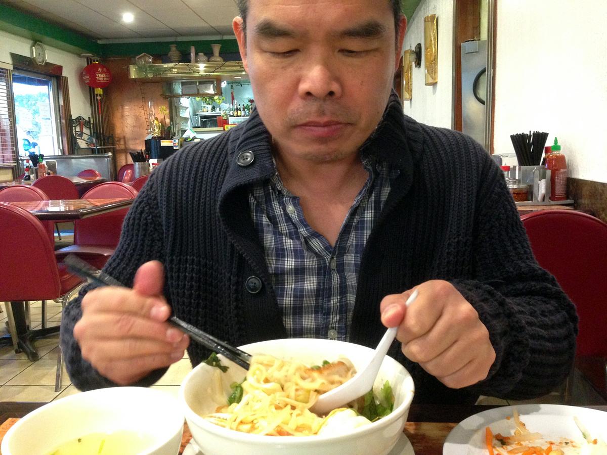 Andrew Lam digs in at Dalet in San Jose. Photo: Rachael Myrow