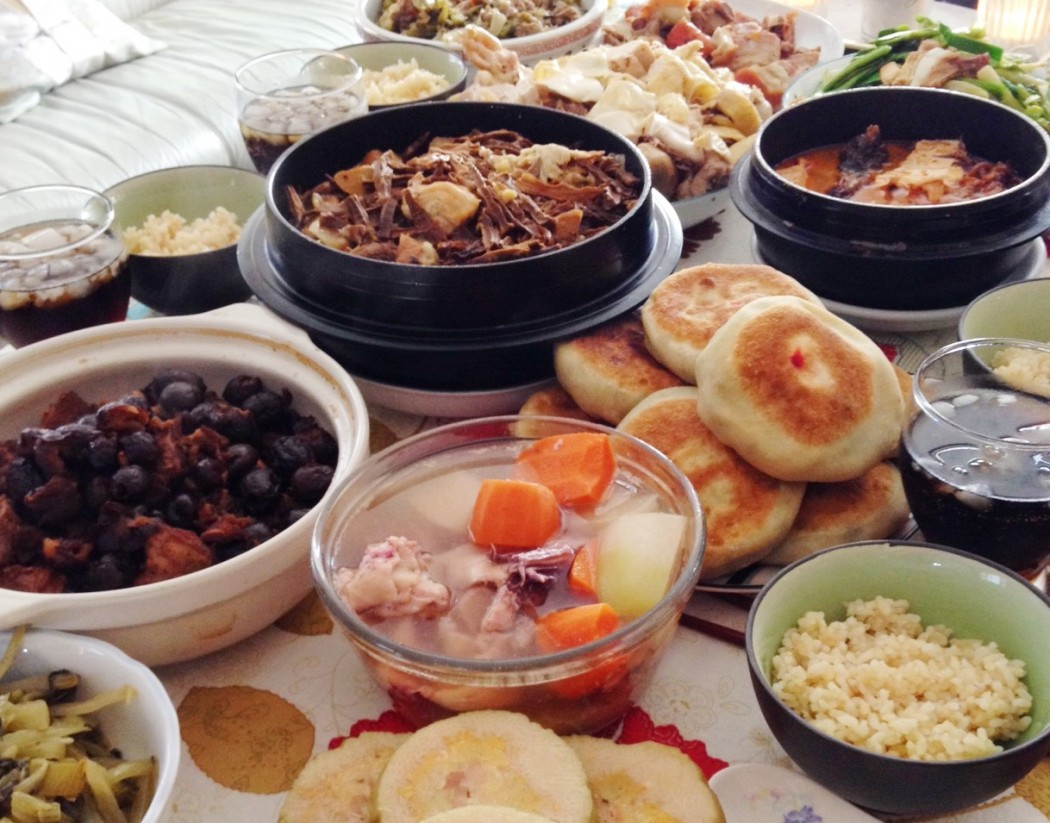 Spread with Sticky Rice, Soup, Rice, Pickles, Chive Cakes. Photo by Elizabeth My-Tuyen Phu.