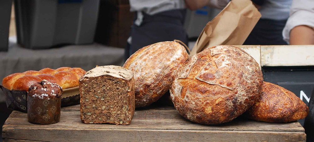 This partial line-up of enticements will soon be available beyond a couple of farmers markets. It includes chocolate brioche, seedy pumpernickel rye and crusty breads. Photo: Susan Hathaway