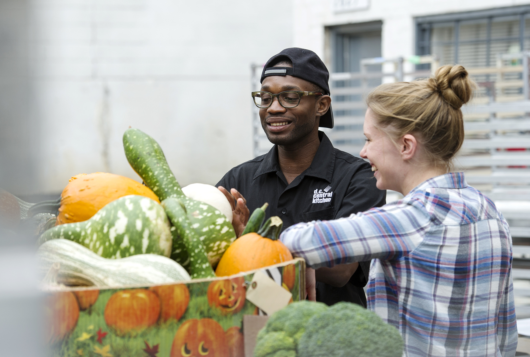 Student volunteers with The Campus Kitchens Project evaluate produce. The initiative gets high-school and college students to scavenge food from cafeterias, grocery stores and farmers' markets, cook it and deliver it to organizations serving low-income people in their communities. Photo: Courtesy of DC Central Kitchen