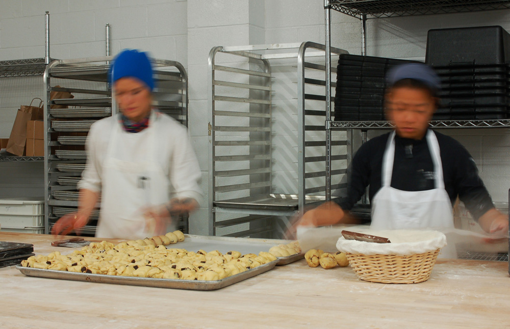 Two of the skilled bakers of ManresaBread make orange chocolate brioche in the new facility. Photo: Susan Hathaway