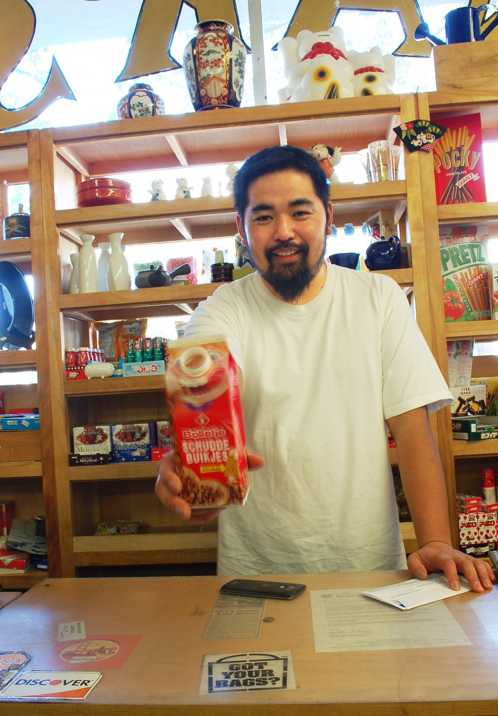 Proprietor Ken Kurose of Nak's Oriental Market freely and frequently offers samples, deals and smiles to customers of his tiny Menlo Park store. Photo: Susan Hathaway
