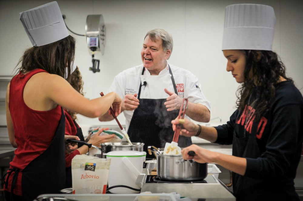Chef David Iott explains the perfect way to prepare risotto to Stanford students. Photo: Courtesy of Stanford's Residential and Dining Enterprises