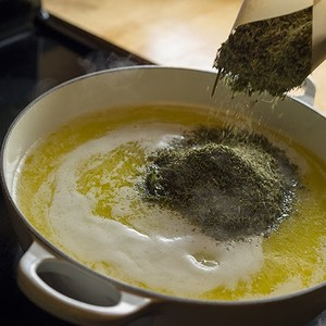 Making CannaButter. Photo courtesy of Feastly