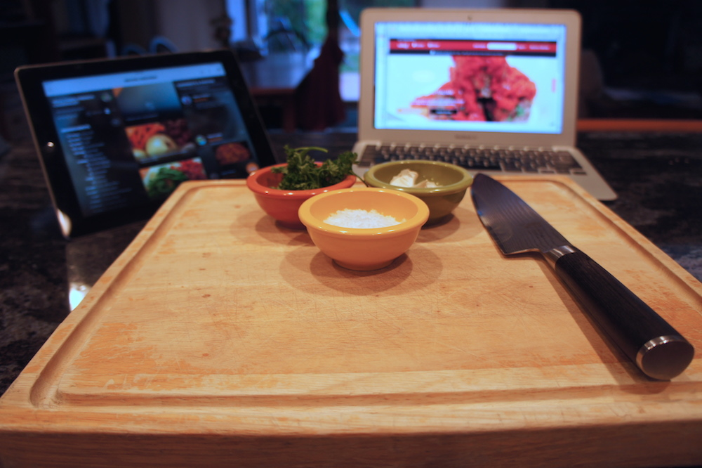 A tablet, computer, and smartphone are becoming helpful kitchen tools. Photo: Angela Johnston