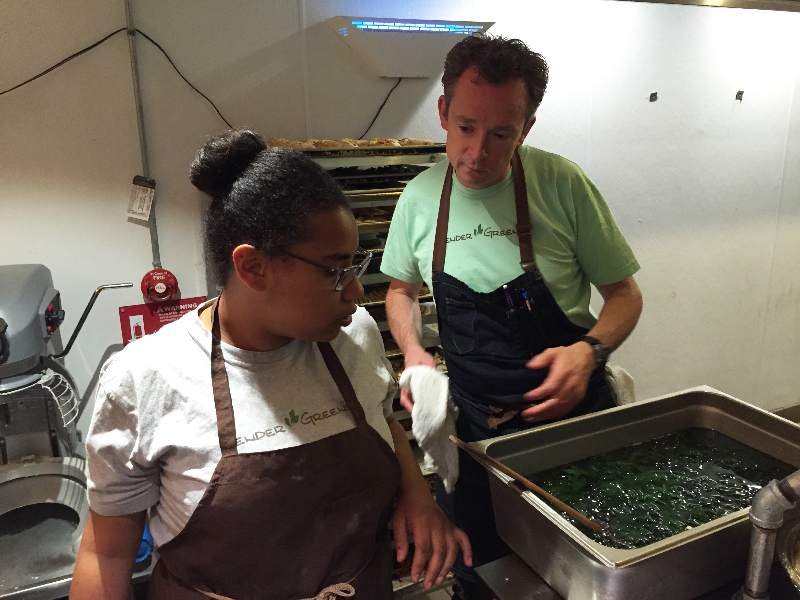 Tender Greens executive chef Sean Eastwood supervises Caridad Johnson blanch spinach. Photo: Alix Wall