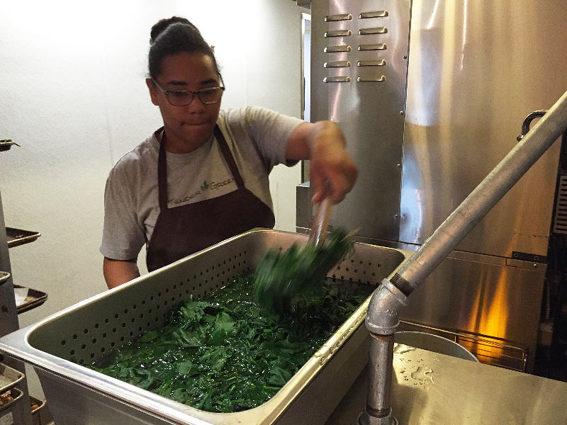 Cari Johnson blanches spinach and then puts it in an ice bath to cool before making ravioli. Photo: Alix Wall